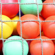 Rope net with colorful ball - Stock Photo