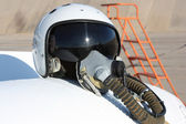 Protective helmet of the pilot against the plane — Stock Photo