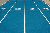 Blue running track — Stock Photo