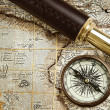 Royalty-Free Stock Photo: Vintage brass telescope and compass at old map