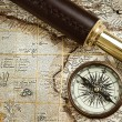 Vintage brass telescope and compass at old map — Stock Photo