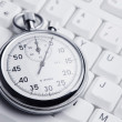 Stopwatch on white keyboard — Stock Photo #6042078