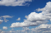Calm fluffy clouds wallpaper — Stock Photo