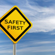 Safet First road sign against  blue sky — Stock Photo