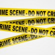 Yellow crime scene tape on white background — Stock Photo