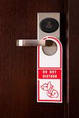 """Hotel door handle with """"do not disturb"""" sign — Stock Photo"""