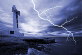 Lighthouse in storm — Stock Photo