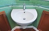 Bathroom with green mosaic tiles — Stock Photo