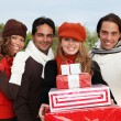 Group of party goers with gifts — Stock Photo
