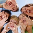 Happy group of kids singing at summer school, — Stockfoto