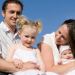 Young happy family mum dad and kids — Stock Photo