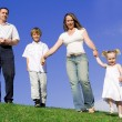 Happy young family parents and children — Stock Photo