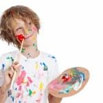 Child with paint brush planning mischief — Stock Photo