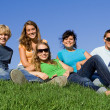 Group of happy teens or students in summer — Stock Photo