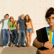 Group of bulllies bullying lonely student - Stock Photo