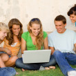 Kids with laptop looking at internet — Stock Photo
