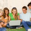 Stock Photo: Kids with laptop looking at internet