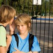 Stock Photo: School kids whispering problems