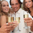 Group of toasting with champagne at party — Stock Photo #6361541