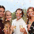 Celebration party with champagne and confetti — Stock Photo