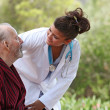 Nurse and patient home care (focus on man) - Stock Photo