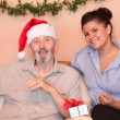 Stock Photo: Senior elderly man with carer at christmas holidays