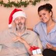Senior elderly man with carer at christmas holidays — Stock Photo