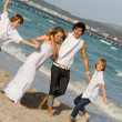 Happy family group on summer vacation - Stock Photo