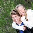 Piggyback fun couple - Foto Stock