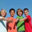 Foto de Stock  : Group of divderse kids at summer camp with thumbs up