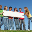 Group of diverse children holding blank white poster — Stok Fotoğraf #6361635