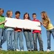 Group of diverse children holding blank white poster — Stock fotografie