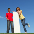 Kids with blank sign - Stock Photo