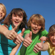 Foto Stock: Group of kids with thumbs up