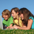 Group of kids with computer on internet — Stock Photo