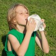 Young child sneezing from allergies, hayfever or a cold — Stock Photo