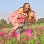 Summer piggyback fun — Stock Photo
