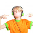 Child blowing gum an listening to music with headphones — Stock Photo