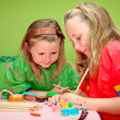 Happy children playing drawing and making craft in class at kind - Stock Photo