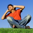 Teen boy singing listening to music with headphones — Stok fotoğraf