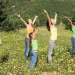 Family group arms raised singing - Stockfoto