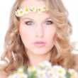 Beautiful healthy hair and camomile flowers — Stock Photo