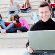 Boy university student with laptop or notebook — Foto de Stock