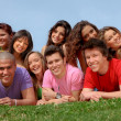 Foto Stock: Group of happy smiling teenager friends