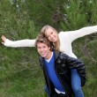 Piggyback couple - Stockfoto