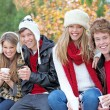 Happy autumn or fall group of teens — Zdjęcie stockowe #6361812