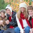 Foto Stock: Happy autumn or fall group of teens