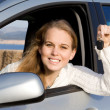 Stock Photo: Womwith new car, hire or rental