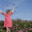 Happy summer child with flowers - Lizenzfreies Foto
