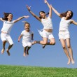 Happy girls jumping at summer camp — Stock Photo #6361861